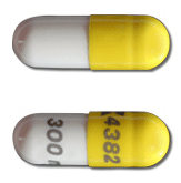Image of white and yellow pill imprinted 4382 / 300 mg